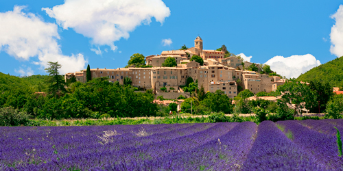 France Provence Hilltop village of Banon Viewed over Lavender field