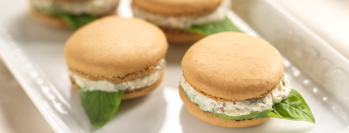Savory sandwich style macaron cookies, stuffed with tomato, feta cheese, and basil.
