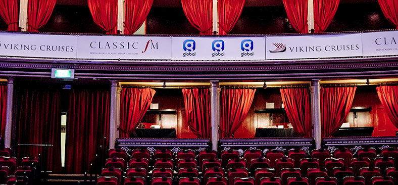 Classic FM and Viking Cruises banners on theater balcony