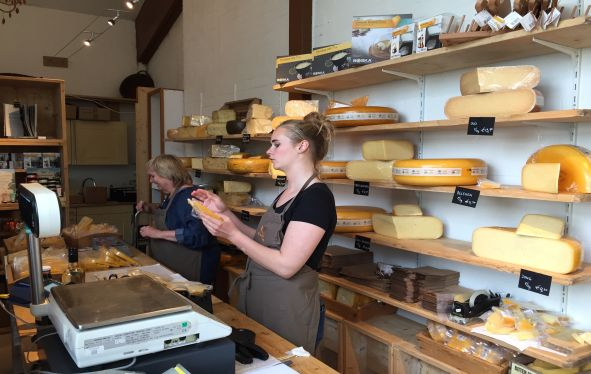European cheese shop with attendant