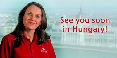 "A woman in a red Viking shirt with the words ""See you soon in Hungary!"" overlayed in red text."