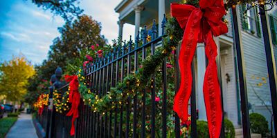 Holiday decorations on a fence