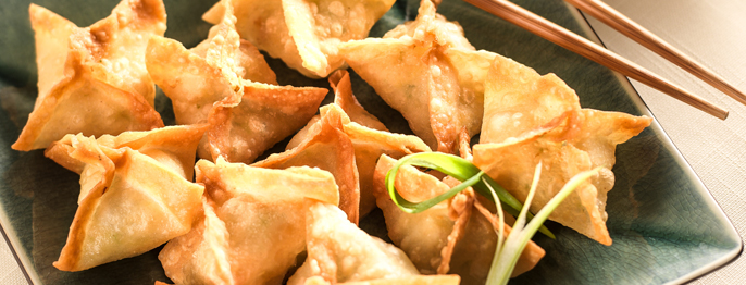 Golden brown fried wontons pinched into square packages containing shrimp and crab.