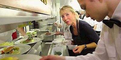 Karine Hagen in the kitchen with Viking Chefs working the line.
