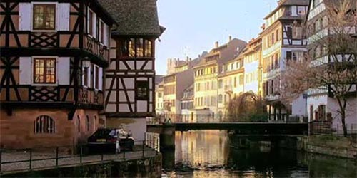 Half-timbered homes along a river in a European town
