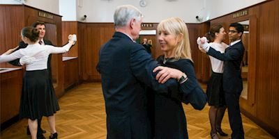 Six people dancing a Viennese waltz