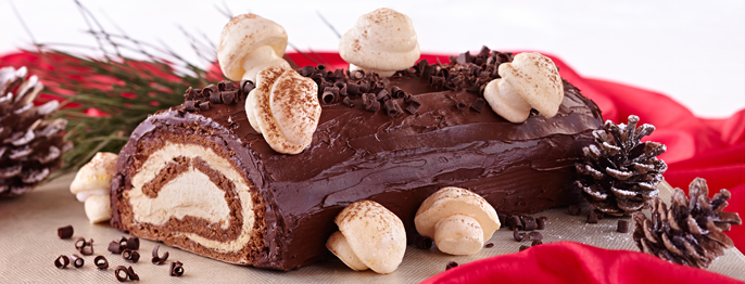 Chocolate sponge rolled into a spiral with white buttercream and decorated to look like a log, complete with edible mushrooms.